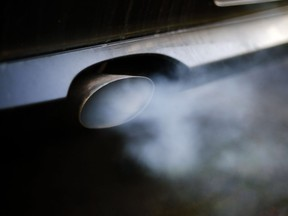 (FILES) A file photo taken on February 21, 2018, shows exhaust gases pourring out of from the exhaust pipe of a BMW diesel engine car at a garage in Wickede, eastern Germany. - The European countries were trying on October 9, 2018 in Luxembourg to overcome their divisions on the magnitude of the reduction in CO2 emissions to impose on car manufacturers.