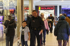 Const. Ryan Wolinski shops with Benjamin, 8, as part of the 2018 Cop Shop event at St. Vital Centre. Luke Rempel/Postmedia