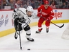DETROIT, MICHIGAN - DECEMBER 10:  Brendan Leipsic #14 of the Los Angeles Kings controls the puck in front of Dylan Larkin #71 of the Detroit Red Wings during the first period at Little Caesars Arena on December 10, 2018 in Detroit, Michigan. (Photo by Gregory Shamus/Getty Images)