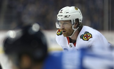 Chicago Blackhawks defenceman Duncan Keith lines up for a faceoff against the Winnipeg Jets in Winnipeg on Tues., Dec. 11, 2018. Kevin King/Winnipeg Sun/Postmedia Network
