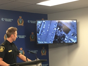 Winnipeg Police Service spokesperson Const. Jay Murray speaks as a video compilation of three incidents involving Winnipeg Police Service's AIR1 helicopter plays in the background at a media briefing on Sunday, Jan. 6, 2019. The incidents occurred on Dec. 30 and Dec. 31, 2018 involving two stolen vehicle arrests and the arrest of an armed robbery suspect. GLEN DAWKINS/Winnipeg Sun/Postmedia Network