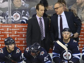 Winnipeg Jets head coach Paul Maurice (right) speaks with assistant Jamie Kompon on the bench during a break in action against the Vegas Golden Knights in Winnipeg on Tues., Jan. 15, 2019. Kevin King/Winnipeg Sun/Postmedia Network