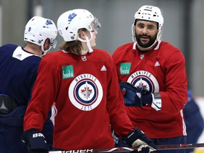 Dustin Byfuglien (right) speaks with Sami Niku during Winnipeg Jets practice at Bell MTS iceplex in Winnipeg on Mon., Feb. 4, 2019. Kevin King/Winnipeg Sun/Postmedia Network