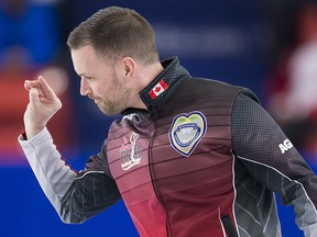 Team Canada skip Brad Gushue throws a piece of dirt that he believes threw off his rock in the second end during the Page Playoff 3 vs 4 game against Team Wild Card at the Brier in Brandon, Man. Saturday, March, 9, 2019. (THE CANADIAN PRESS/Jonathan Hayward)