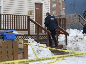Forensics officers from the Winnipeg Police Service investigate at the scene of a homicide in the 400 block of Langside Street on Mon., March 18, 2019. Police say a man was assaulted at about 7 p.m. on Sunday night. Kevin King/Winnipeg Sun/Postmedia Network