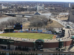 Shaw Park (foreground) and the Provencher Bridge and Esplanade Riel as seen from the roof of the Fairmont Hotel in Winnipeg on Fri., April 8, 2016. Kevin King/Winnipeg Sun/Postmedia Network