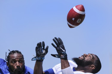 Winnipeg Blue Bombers defensive back Travon Blanchard (42), left, defends wide receiver Rasheed Bailey (3) during at team mini -camp at IMG Academy in Bradenton Florida on Wednesday, April 24, 2019.  Photo by Tom O'Neill