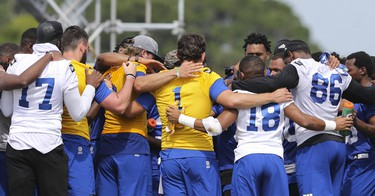 Winnipeg Blue Bombers teammates huddle at the end of a team mini-camp at IMG Academy in Bradenton Florida on Thursday, April 25, 2019.  Photo by Tom O'Neill