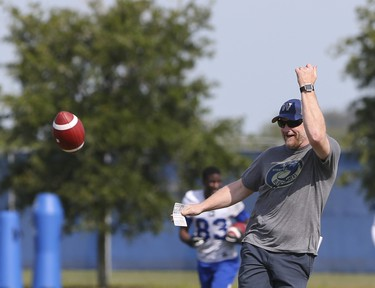 Winnipeg Blue Bombers Head Coach Mike O'Shea tosses an errant pass back to players during a team mini-camp at IMG Academy in Bradenton Florida on Thursday, April 25, 2019.  Photo by Tom O'Neill