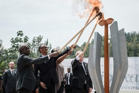 TOPSHOT - (From L) African Union chief Moussa Faki, Rwanda's President Paul Kagame, his wife Jeannette (2ndR), and European Commission President Jean-Claude Juncker light a remembrance flame for the 25th Commemoration of the 1994 Genocide at the Kigali Genocide Memorial in Kigali, Rwanda, on April 7, 2019. - Rwanda on April 7, 2019 began 100 days of mourning for more than 800,000 people slaughtered in a genocide that shocked the world, a quarter of a century on from the day it began. (Photo by Yasuyoshi CHIBA / AFP)YASUYOSHI CHIBA/AFP/Getty Images