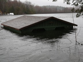 A boat house is covered by the flood on Lake McGregor in Val-des-Monts, Que., April 26, 2019.