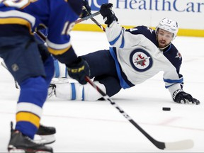 Jets' Josh Morrissey slides to block the puck during the second period of Game 4 on Tuesday night against the Blues in St. Louis.AP