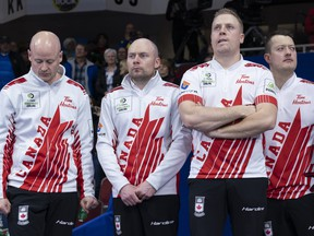 Canada skip Kevin Koe, third B.J. Neufeld, second Colton Flasch, lead Ben Hebert, left to right, stand on the podium after losing to Sweden in the gold medal game at the Men's World Curling Championship in Lethbridge, Alta. on Sunday, April 7, 2019. THE CANADIAN PRESS/Paul Chiasson