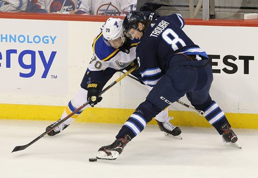 WINNIPEG, MANITOBA - APRIL 10: Oskar Sundqvist #70 of the St. Louis Blues battles Jacob Trouba #8 of the Winnipeg Jets in Game One of the Western Conference First Round during the 2019 NHL Stanley Cup Playoffs at Bell MTS Place on April 10, 2019 in Winnipeg, Manitoba, Canada. (Photo by Jason Halstead/Getty Images)
