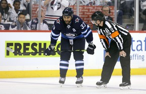 Dustin Byfuglien of the Winnipeg Jets chats to a referee during a break in action with the St. Louis Blues in Game One of the Western Conference First Round during the 2019 NHL Stanley Cup Playoffs at Bell MTS Place on April 10, 2019 in Winnipeg.