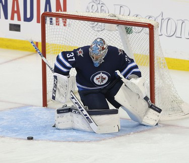 WINNIPEG, MANITOBA - APRIL 10: Connor Hellebuyck #37 of the Winnipeg Jets makes a save against the St. Louis Blues in Game One of the Western Conference First Round during the 2019 NHL Stanley Cup Playoffs at Bell MTS Place on April 10, 2019 in Winnipeg, Manitoba, Canada. (Photo by Jason Halstead/Getty Images)