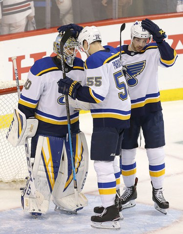 WINNIPEG, MANITOBA - APRIL 10: Colton Parayko #55 of the St. Louis Blues congratulates goalie Jordan Binnington #50 after defeating the Winnipeg Jets in Game One of the Western Conference First Round during the 2019 NHL Stanley Cup Playoffs at Bell MTS Place on April 10, 2019 in Winnipeg, Manitoba, Canada. (Photo by Jason Halstead/Getty Images)