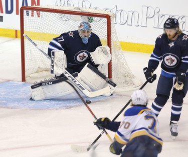 WINNIPEG, MANITOBA - APRIL 10: Oskar Sundqvist #70 of the St. Louis Blues shoots on Connor Hellebuyck #37 of the Winnipeg Jets in Game One of the Western Conference First Round during the 2019 NHL Stanley Cup Playoffs at Bell MTS Place on April 10, 2019 in Winnipeg, Manitoba, Canada. (Photo by Jason Halstead/Getty Images)