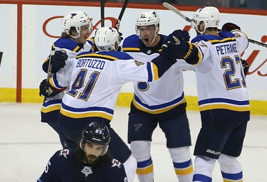 St. Louis Blues centre Tyler Bozak (second from right) celebrates his game-winning goal against the Winnipeg Jets during Game 1 of Round 1 of the NHL playoffs in Winnipeg with Robert Thomas, Robert Bortuzzo and Alex Pietrangelo (from left) on Wed., April 10, 2019. Kevin King/Winnipeg Sun/Postmedia Network