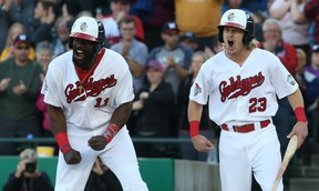 Josh Romanski (right) drove in a run during Tuesday's win over the T-Bones. (KEVIN KING/ WINNIPEG SUN FILES)