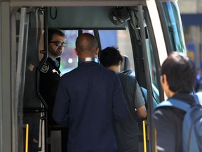 Transit riders queue to pay their fare at a stop on Osborne Street in Winnipeg on Mon., May 13, 2019. The Amalgamated Transit Union 1505, without a contract since January, took job action where its drivers didn't enforce fare payment. ATU members are voting on the city's contract offer this week and expect results by Friday, May 31. Kevin King/Winnipeg Sun/Postmedia Network file