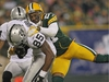 GREEN BAY, WI - DECEMBER 11: Darrius Heyward-Bey #85 of the Oakland Raiders is tackled by Charles Woodson #21 of the Green Bay Packers at Lambeau Field on December 11, 2011 in Green Bay, Wisconsin. The Packers defeated the Raiders 46-16.  (Photo by Jonathan Daniel/Getty Images)