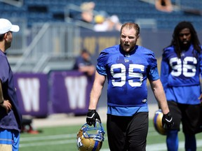 Jake Thomas (95) lets out a holler during Winnipeg Blue Bombers training camp at IG Field on Tues., June 4, 2019. Kevin King/Winnipeg Sun/Postmedia Network