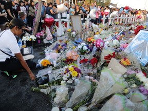 EL PASO, TEXAS - AUGUST 06: People gather at a makeshift memorial honoring victims outside Walmart, near the scene of a mass shooting which left at least 22 people dead, on August 6, 2019 in El Paso, Texas.  A 21-year-old white male suspect remains in custody in El Paso, which sits along the U.S.-Mexico border. President Donald Trump plans to visit the city August 7.