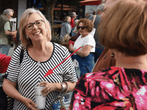 This version of the photo that was posted to the Green Party website shows Elizabeth May holding a reusable cup with a metal straw that were Photoshopped in.