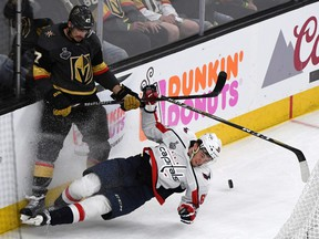 LAS VEGAS, NV - MAY 28:  Luca Sbisa #47 of the Vegas Golden Knights and Andre Burakovsky #65 of the Washington Capitals crash into the boards in the second period of Game One of the 2018 NHL Stanley Cup Final at T-Mobile Arena on May 28, 2018 in Las Vegas, Nevada. The Golden Knights defeated the Capitals 6-4.  (Photo by Ethan Miller/Getty Images)