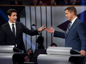 Conservative leader Andrew Scheer (R) and Canadian Prime Minister and Liberal leader Justin Trudeau gesture to each other during the Oct. 7, 2019 leaders debate. (Photo by JUSTIN TANG/POOL/AFP via Getty Images)
