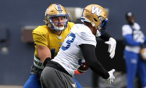 Quarterback Chris Streveler (left) practises the read-option play with running back Andrew Harris during Blue Bombers practice at IG Field this week. The Bombers face the Riders at Mosaic Stadium tonight.(Kevin King/Winnipeg Sun)