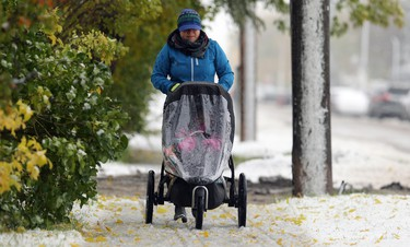Chantal Young pushes her child along Doncaster Street in the Tuxedo area of Winnipeg on Thurs., Oct. 10, 2019. Kevin King/Winnipeg Sun/Postmedia Network