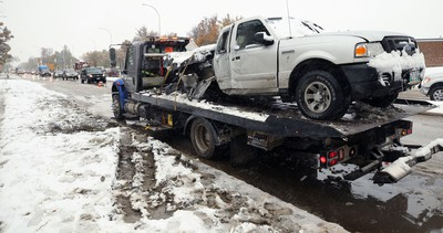 A Ford Ranger that hit a light standard and had its gas tank ripped open sits on a flatbed tow truck on Kenaston Boulevard near Tuxedo Avenue in Winnipeg on Thurs., Oct. 10, 2019. Kevin King/Winnipeg Sun/Postmedia Network