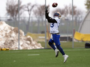 Running back Andrew Harris makes a jumping catch during Winnipeg Blue Bombers practice on the University of Manitoba campus on Wed., Oct. 16, 2019. Kevin King/Winnipeg Sun/Postmedia Network