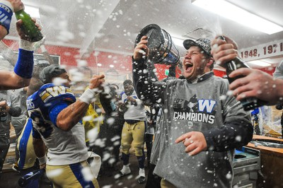 CALGARY, AB - NOVEMBER 24: Andrew Harris #33 of the Winnipeg Blue Bombers celebrates with his teammates after defeating the Hamilton Tiger-Cats during the 107th Grey Cup Championship Game at McMahon Stadium on November 24, 2019 in Calgary, Alberta, Canada. (Photo by Derek Leung/Getty Images)
