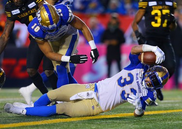Andrew Harris of the Winnipeg Blue Bombers goes in for a touchdown during the 107th Grey Cup CFL championship football game in Calgary on Sunday, November 24, 2019. Al Charest/Postmedia
