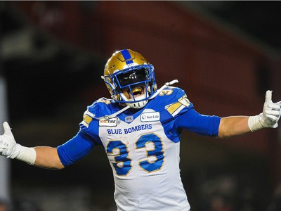 CALGARY, AB - NOVEMBER 24: Andrew Harris #33 of the Winnipeg Blue Bombers celebrates after scoring a touchdown against the Hamilton Tiger-Cats during the 107th Grey Cup Championship Game at McMahon Stadium on November 24, 2019 in Calgary, Alberta, Canada. (Photo by Derek Leung/Getty Images) ORG XMIT: 775411982