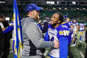 Winnipeg Blue Bombers head coach Mike O'Shea and Winnipeg Blue Bombers defensive back Marcus Sayles (14) after defeating Saskatchewan Roughriders during the CFL Western Conference Final football game at Mosaic Stadium  Sergei Belski-USA TODAY Sports