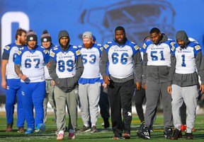 From left: Blue Bombers' Asotui Eli, Kenny Lawler, Patrick Neufeld, Stanley Bryant, Jermarcus Hardrick and Darvin Adams gather during the team's final walkthrough on Saturday in preparation for Sunday's Grey Cup game against the Hamilton Tiger-Cats in Calgary. (AL CHAREST/POSTMEDIA NETWORK)