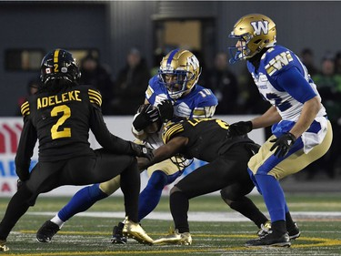 Nov 24, 2019; Calgary, Alberta, CAN; Winnipeg Blue Bombers wide receiver Nic Demski (10) runs the ball tackled by Hamilton Tiger-Cats quarterback David Watford (6) in the first half during the 107th Grey Cup championship football game at McMahon Stadium. Mandatory Credit: Eric Bolte-USA TODAY Sports