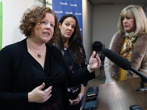 Nicole Chammartin (left), Klinic executive director, speaks while Laurel Centre executive director Heather Leeman (centre) and Cathy Cox, minister responsible for the status of women, listen following a press conference to announce a $2.4 million investment over three years for expanded walk-in mental health services and specialized trauma counselling, at Klinic Community Health on Portage Avenue in Winnipeg, on Mon., Nov. 4, 2019. Kevin King/Winnipeg Sun/Postmedia Network