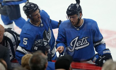 Winnipeg Jets defenceman Anthony Bitetto (right) makes a point to Nathan Beaulieu (seated) with Luca Sbisa chiming in during a break in action against the New Jersey Devils in Winnipeg on Tues., Nov. 5, 2019. Kevin King/Winnipeg Sun/Postmedia Network