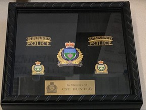 Photo of the shadow box containing a Winnipeg Police Service badge and certificate presented by the Winnipeg Police Service to the family of Hunter Haze Straight-Smith at the three-year-old's wake service on Friday evening.