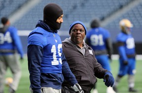 Defensive co-ordinator Richie Hall (right) chats with linebacker Kyrie Wilson during Winnipeg Blue Bombers practice in Winnipeg on Wednesday, Nov. 13.