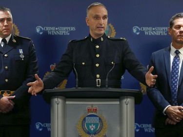 Insp. Max Waddell (centre) of the Winnipeg Police Service organized crime unit, along with Det. Insp. Jim Walker (left) the deputy director of the Ontario Provincial Police central organized crime enforcement bureau, and Ron Bell, supervisor of the special investigations unit for Manitoba Finance and Taxation, speak to media about Project Highland at WPS headquarters on Mon., Dec. 23, 2019. Kevin King/Winnipeg Sun/Postmedia Network