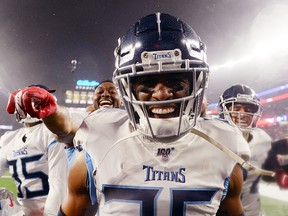 Logan Ryan of the Tennessee Titans celebrates his touchdown with teammates against the New England Patriots in the fourth quarter of the AFC Wild Card game at Gillette Stadium on January 4, 2020 in Foxborough. (Kathryn Riley/Getty Images)