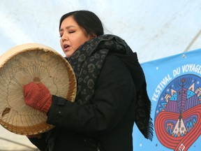 Lisa Muswagon of Cross Lake First Nation performs with a hand drum during the Festival du Voyageur kickoff press conference at Whittier Park in Winnipeg on Thurs., Feb. 13, 2020. Kevin King/Winnipeg Sun/Postmedia Network