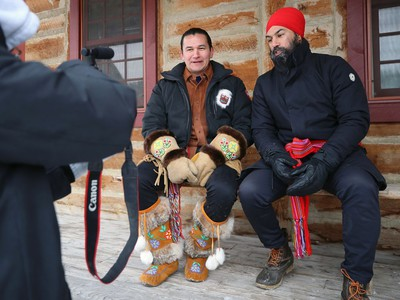 Federal New Democratic Party leader Jagmeet Singh (right) and Manitoba NDP leader Wab Kinew film a video for social media in which Singh opened with 'How do you do? I'm Wab Kinew?' and Kinew said 'What did you bring? I'm Jagmeet Singh' within Fort Gibraltar at Whittier Park as the two celebrate Louis Riel Day at Festival du Voyageur in Winnipeg on Mon., Feb. 17, 2020. Kevin King/Winnipeg Sun/Postmedia Network