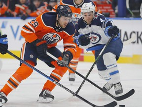 Edmonton Oilers forward Leon Draisaitl (29) carries the puck past Winnipeg Jets defensemen Neal Pionk (4) during the first period at Rogers Place.
